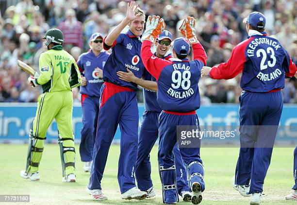 England celebrates after taking the wicket of Pakistan's Shoaib Malik during a 20/20 cricket game at the County Ground in southwest England 28 August...