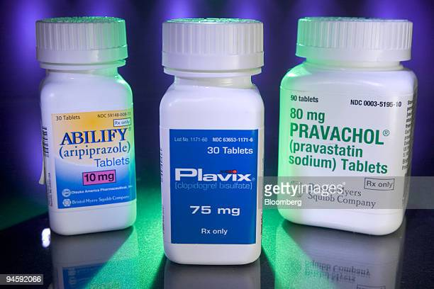 BristolMyers Squibb products Plavix Abilify and Pravachol are arranged for an illustration at Skenderian Apothecary in Cambridge Massachusetts on...