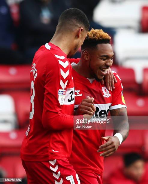 Brit Assombalonga of Middlesbrough celebrates after scoring his team's first goal with team mate Ashley Fletcher during the Sky Bet Championship...