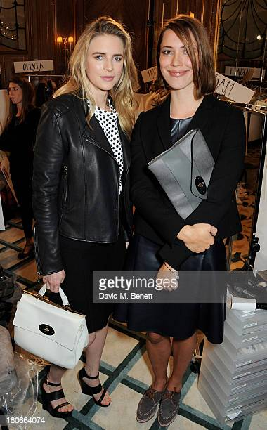 Brit Marling and Rebecca Hall attend the Mulberry Spring/Summer 2014 show during London Fashion Week at Claridges Hotel on September 15 2013 in...