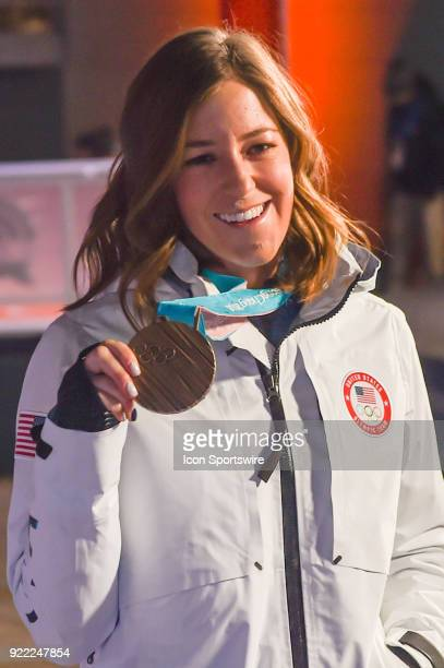 Brita Sigourney proudly shows her bronze medal in women's halfpipe skiing to the crowd before her interview on the set of Today Show in the middle of...