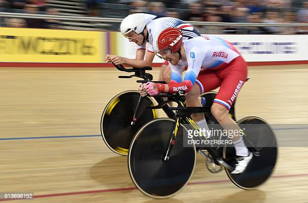 Britain' Andrew Tennant passes Russia's Dmitrii Sokolov during the Men's Individual pursuit qualifying during the 2016 Track Cycling World...