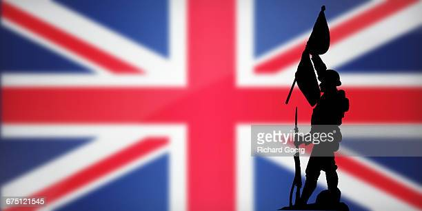 britain flag and soldier - veterans day background stock photos and pictures