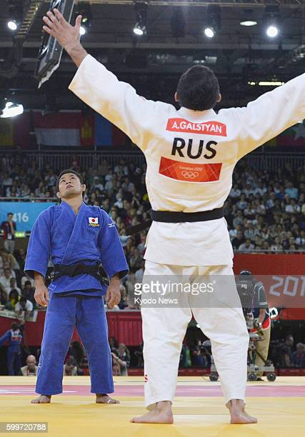 LONDON Britain Hiroaki Hiraoka of Japan stands stunned after his opponent Arsen Galstyan deployed a sweeping wraparound throw to score an ippon...