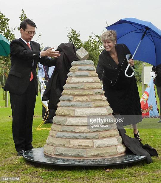 ALREWAS Britain Japanese Ambassador to Britain Keiichi Hayashi takes part in a ceremony on Aug 15 marking the completion of a monument at the...