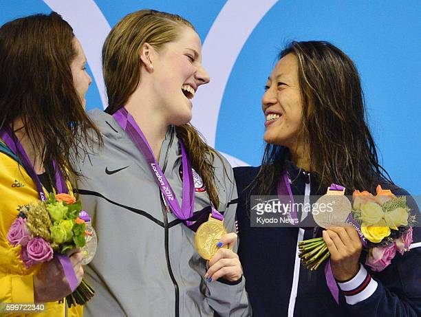 LONDON Britain Japanese bronze medalist Aya Terakawa celebrates with silver medalist Emily Seebohm of Australia and gold medalist Missy Franklin of...
