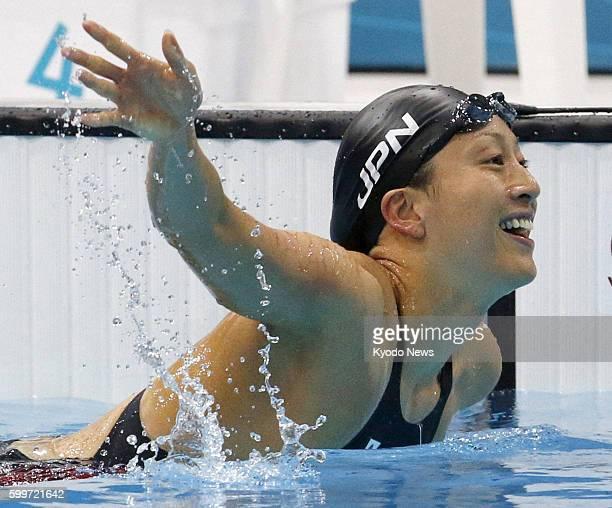 LONDON Britain Japan's Aya Terakawa celebrates after the women's 100meter backstroke semifinals of the 2012 London Olympics at the Aquatics Centre on...