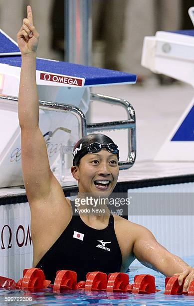 LONDON Britain Japan's Aya Terakawa celebrates her bronze medal finish in the women's 100meter backstroke at the 2012 London Olympics at Aquatics...