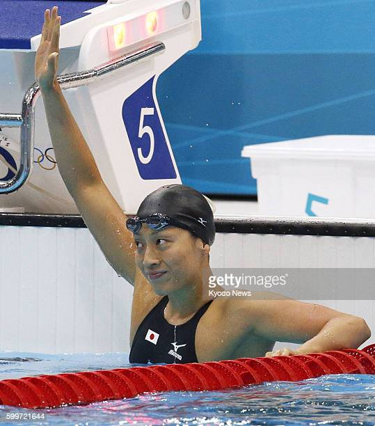 LONDON Britain Japan's Aya Terakawa responds to the cheers after the women's 100meter backstroke semifinals at the 2012 London Olympics at Aquatics...