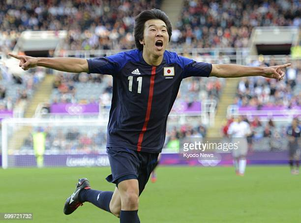 NEWCASTLE Britain Japan's Kensuke Nagai celebrates after scoring his team's winning goal in the second half of a Group D men's soccer match against...