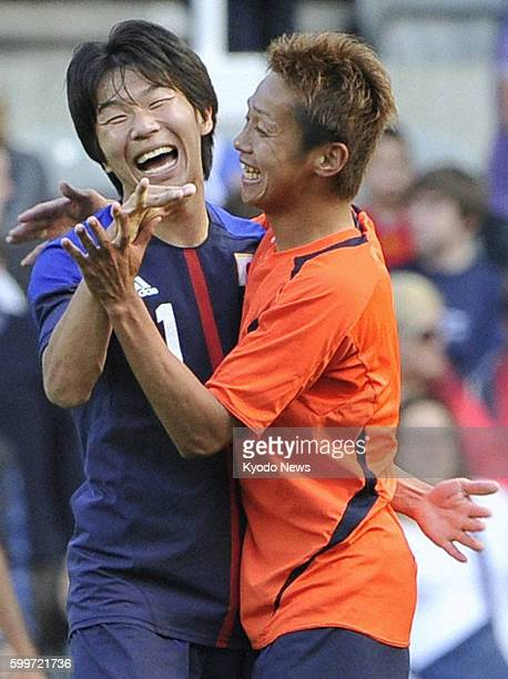 NEWCASTLE Britain Japan's Kensuke Nagai embraces Hiroshi Kiyotake after the men's team's victory in a Group D soccer match against Morocco at St...