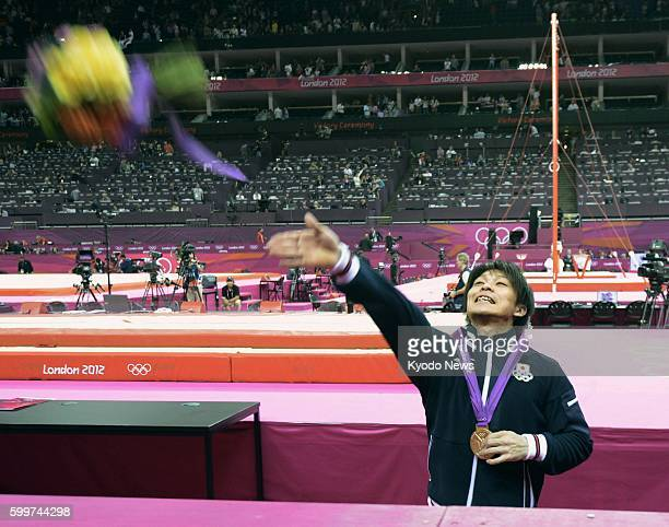 LONDON Britain Japan's Kohei Uchimura throws a flower bouquet to his mother in the audience after the award ceremony for the gold medal he won in the...