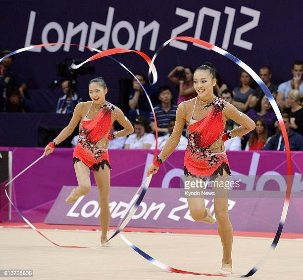 LONDON Britain Japan's Natsuki Fukase and Airi Hatakeyama perform with ribbons during the rhythmic gymnastics team final at the Wembley Arena at the...
