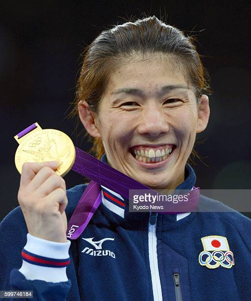 Britain - Japan's Saori Yoshida smiles with the gold medal she won in the women's wrestling 55-kilogram class at the 2012 London Olympics, at the...