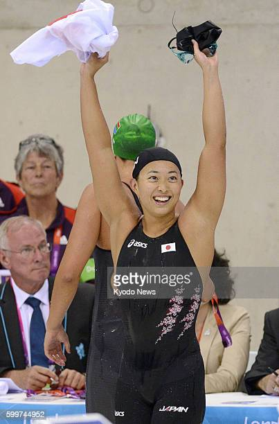 LONDON Britain Japan's Satomi Suzuki responds to cheers after finishing second in the women's 200meter breaststroke final at the Aquatics Centre at...
