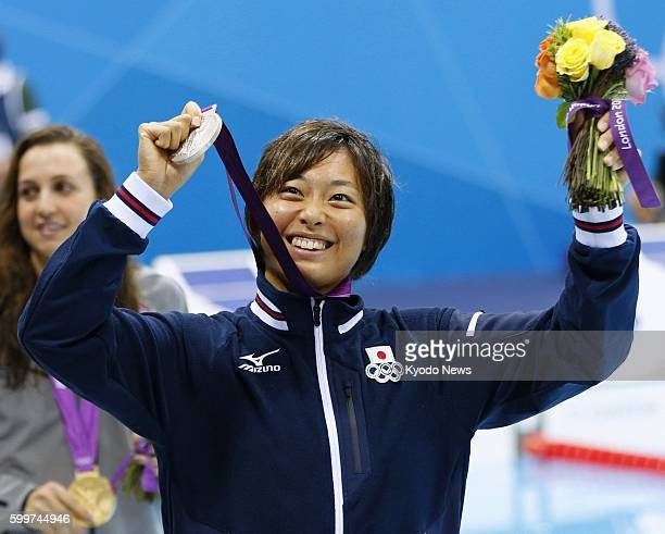 LONDON Britain Japan's Satomi Suzuki responds to cheers with the silver medal she won in the women's 200meter breaststroke at the 2012 London...