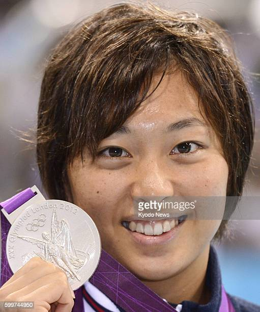 LONDON Britain Japan's Satomi Suzuki shows the silver medal she won in the women's 200meter breaststroke at the 2012 London Olympics at the Aquatics...