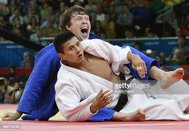 LONDON Britain Japan's Takahiro Nakai is stunned after losing to Russia's Ivan Nifontov in a match for third place in the men's judo 81kilogram...