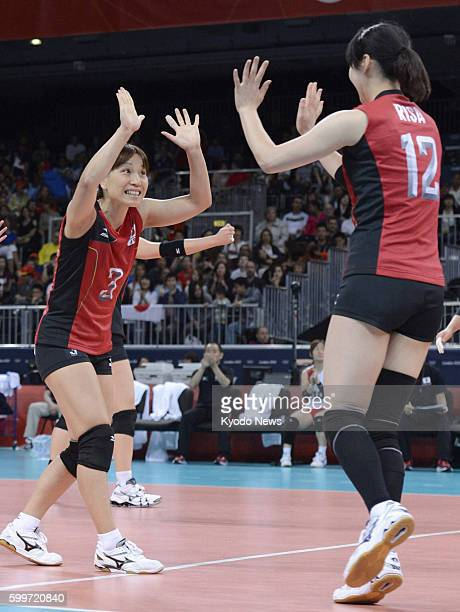 LONDON Britain Japan's Yoshie Takeshita and Risa Shinnabe celebrate after the team scored during the third set of a match against Algeria in the...