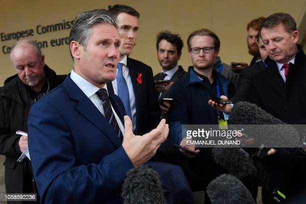 Britain Labour Party Brexit spokesman Keir Starmer gestures as he speaks with the press in front of the entrance of the European Commission building...