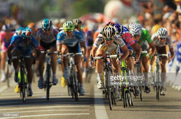 Britain Mark Cavendish of team HTCColumbia crosses the finish to win stage 11 of the Tour de France July 15 2010 in BourglesValence France The 1845km...
