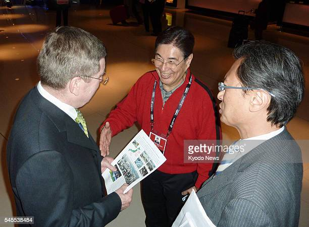 LONDON Britain Masato Mizuno vice president of the Japanese Olympic Committee hands out a leaflet in London on April 3 emphasizing the safeness of...