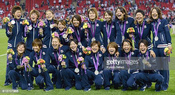 """Britain - Members of the Japan national team """"Nadeshiko Japan"""" smile with the silver medals they won in the women's soccer competition at the 2012..."""