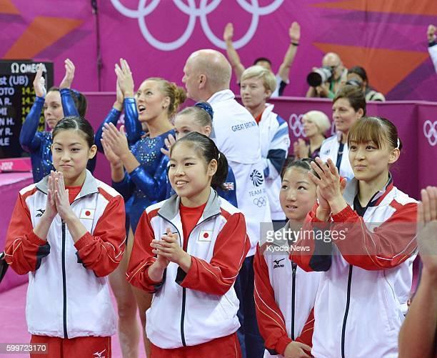 LONDON Britain Members of the Japanese team Yuko Shintake Yu Minobe Asuka Teramoto and Rie Tanaka applaud the US team's victory in the London Olympic...