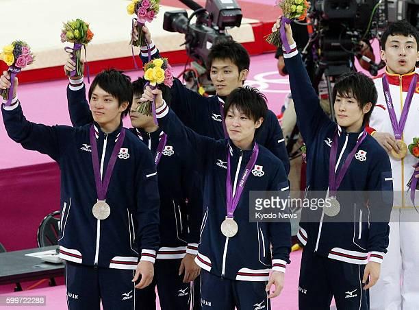 LONDON Britain Members of the Japanese team Yusuke Tanaka Koji Yamamuro Kazuhito Tanaka Kohei Uchimura and Ryohei Kato wave to the crowd after...