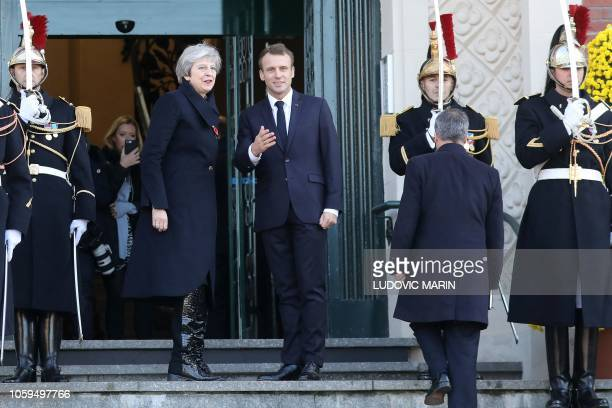 Britain Prime minister Theresa May and French president Emmanuel Macron chat as they pose upon their arrival in Albert northern France on November 9...