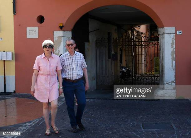 Britain Prime Minister Theresa May walks with her husband Philip in Desenzano del Garda by the Garda lake as they holiday in northern Italy on July...