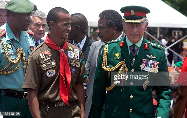 Britain Prince Charles meets with boy scouts after an ecumenical Service of Worship lead by The Bishop of Port Moresby at the Sir John Guise Stadium...