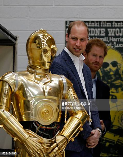 Britain Prince William Duke of Cambridge and Britain's Prince Harry look at droid C3P0 from Star Wars as they visit the creature and droid department...
