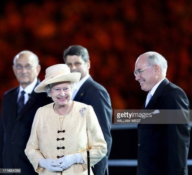 Britain Queen Elizabeth II and head of the Commonwealth smiles as Australian Premier John Howard looks on during the opening ceremony of the...