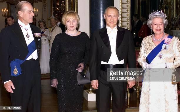 Britain s Queen Elizabeth II and her husband, the Duke of Edinburgh stand alongside Russia s President Putin and his wife, Lyudmila, before a state...