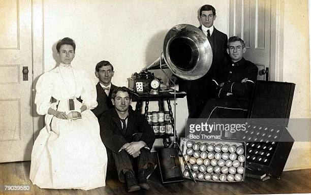 Britain Social History Group of people gathered aroung a cylinder gramophone circa 1900