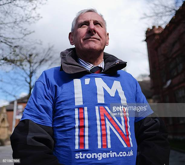 Britain Stronger In Europe supporter hands out flyers as he waits for the campaign bus to arrive at Northumbria University's City Campus on April 16...