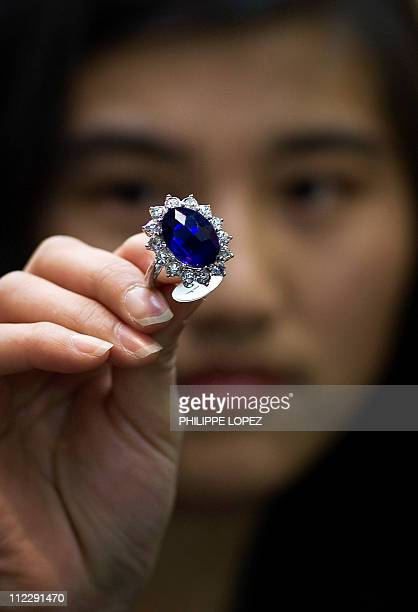 BritainroyalsmarriageChinasouvenirsFEATURE by D'Arcy DoranIn this picture taken on April 12 2011 in Yiwu a Chinese woman holds a replicas of the blue...