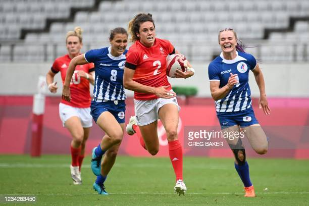 Britain's Abbie Brown runs with the ball in the women's pool A rugby sevens match between Russia and Britain during the Tokyo 2020 Olympic Games at...