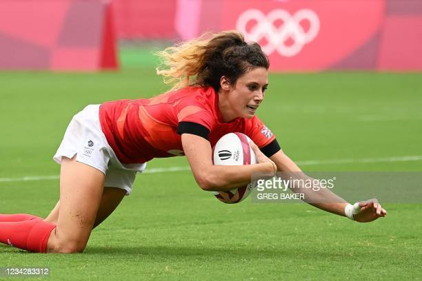Britain's Abbie Brown scores a try during the women's pool A rugby sevens match between Russia and Britain during the Tokyo 2020 Olympic Games at the...