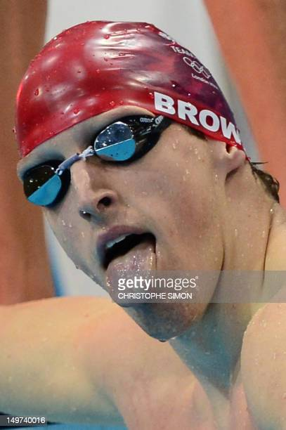 Britain's Adam Brown sticks his tongue out after he competed in the men's 4x100m medley relay heats during the swimming event at the London 2012...
