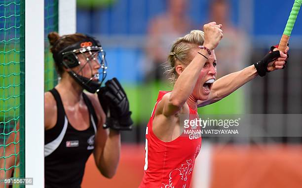 Britain's Alex Danson celebrates after scoring the opening goal during the women's semifinal field hockey New Zealand vs Britain match of the Rio...