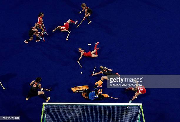 Britain's Alex Danson dives to score a goal during the women's Gold medal hockey Netherlands vs Britain match of the Rio 2016 Olympics Games at the...