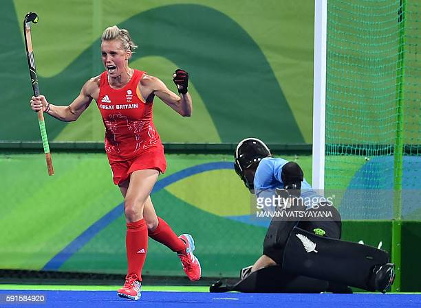 Britain's Alex Danson scores a goal during the women's semifinal field hockey New Zealand vs Britain match of the Rio 2016 Olympics Games at the...