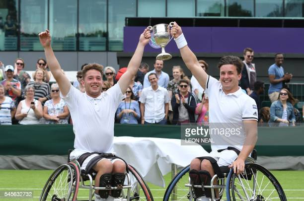 Britain's Alfie Hewett and Gordon Reid pose with their winner's trophy after beating France's Stephane Houdet and Nicolas Peifer in the final of the...