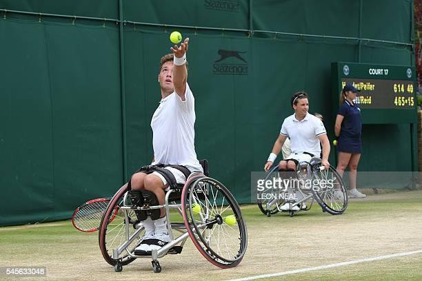 Britain's Alfie Hewett serves as his partner Gordon Reid watches against France's Stephane Houdet and Nicolas Peifer in the final of the men's...