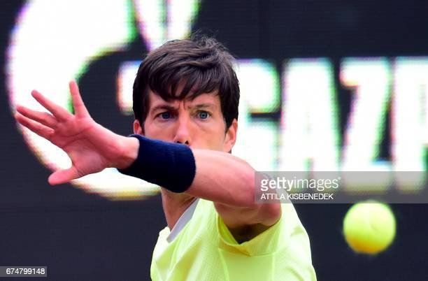 Britain's Aljaz returns the ball to Serbia's Laslo Djere during their semifinal tennis match at the Hungarian Open in Budapest on April 29 2017...