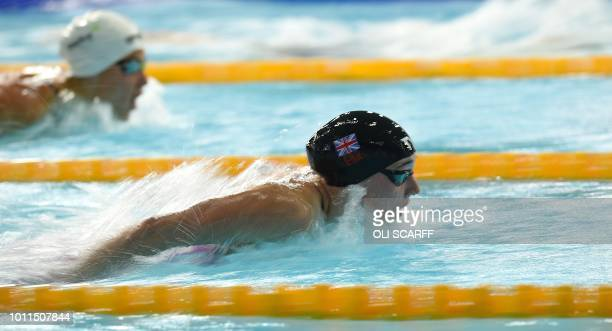 Britain's Alys Thomas competes to win the Women's 200m butterfly swimming semifinal at the Tollcross swimming centre during the 2018 European...