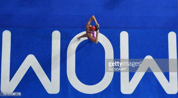 TOPSHOT Britain's Alys Thomas leaves the pool after competing in the Women's 50m butterfly swimming qualifier at the Tollcross swimming centre during...