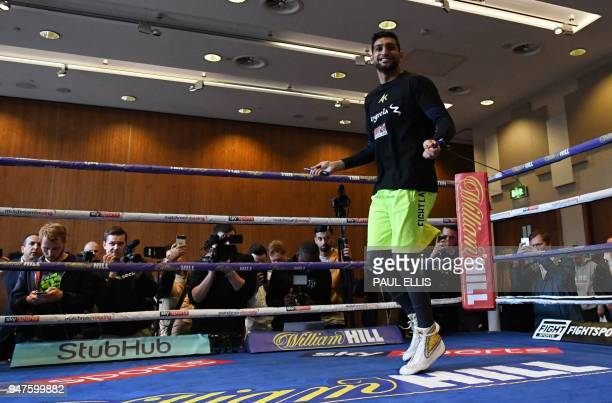 Britain's Amir Khan attends a prefight public work out at Paradise Place in Liverpool on April 17 ahead of his welterweight boxing bout against...